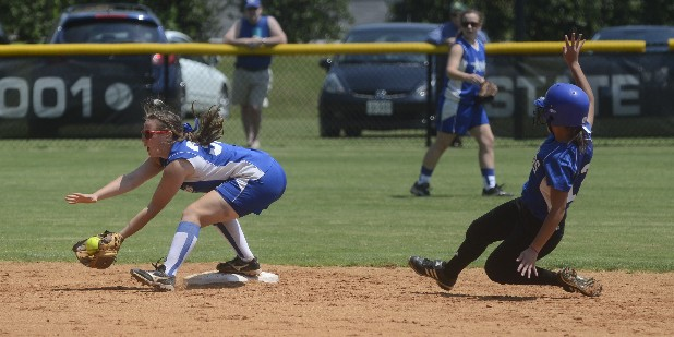 GPS' Kelby Crownover is called out as St. Agnes' Hailey Freres fields the ball during the game Thursday at GPS.