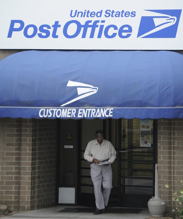 A customer leaves the post office at 6050 Shallowford Road on May 9.