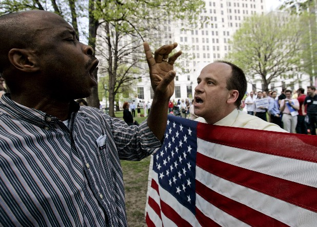 Gay rights advocate Matthew Arnold-Lloyd of Albany, N.Y., right, argues with an unidentified man opposed to gay marriage during a rally outside the Capitol in Albany. A flurry of political activity in states such as Rhode Island, Illinois and Colorado followed President Barack Obama's declaration of support for gay marriage, which has emboldened activists and politicians on both sides of the issue ahead of anticipated votes in four states this fall, including Maine and Maryland.