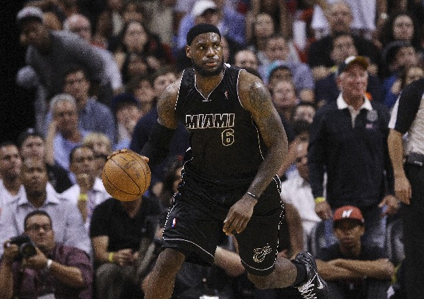 Miami Heat's LeBron James looks down court during the first half of a NBA basketball against the Oklahoma City Thunder in Miami.