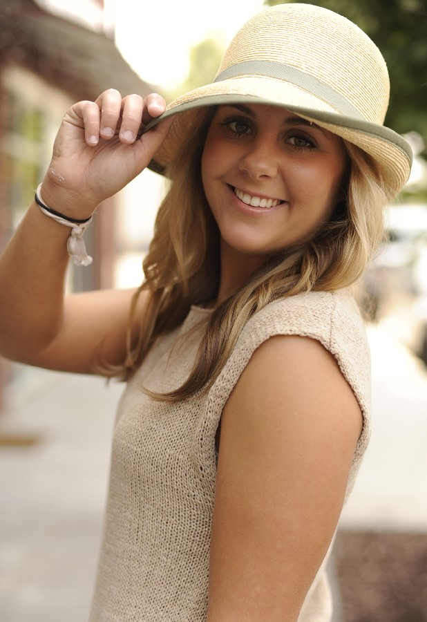 "Sarah Eck wears a ""Ms. Melissa"" hat, $59."