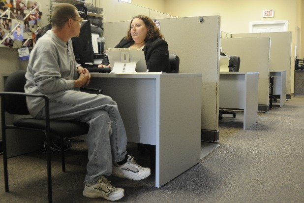 Randall Land, left, talks with staffing consultant Mindy Davis Wednesday at Express Employment Professionals.