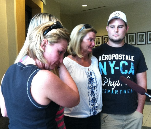 Kathy Van Kleeck , surrounded by family, urges her brother Sonny Neal to turn himself in to authorities at the Whitfield County Sheriff's Office on Friday. Neal is charged with killing his wife, Jessica, and her grandfather, Donald Shedd, on Thursday.