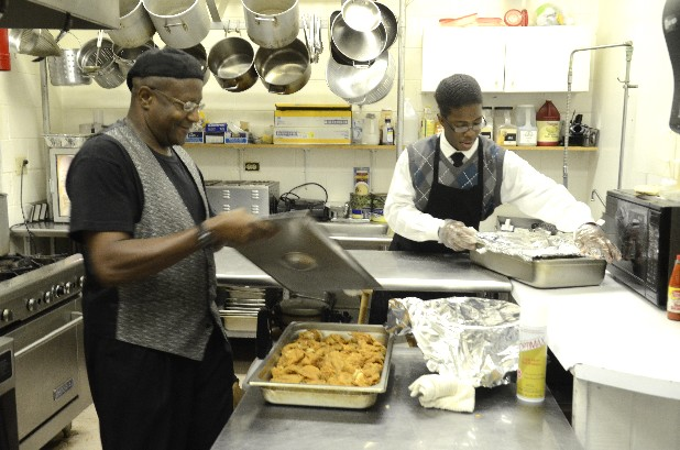 Roy Newton, left, and  and Demetrius Goins work in the kitchen of the Bistro @ the Beth, an all-you-care-to-eat restaurant open to the public in the Bethlehem Community Center.