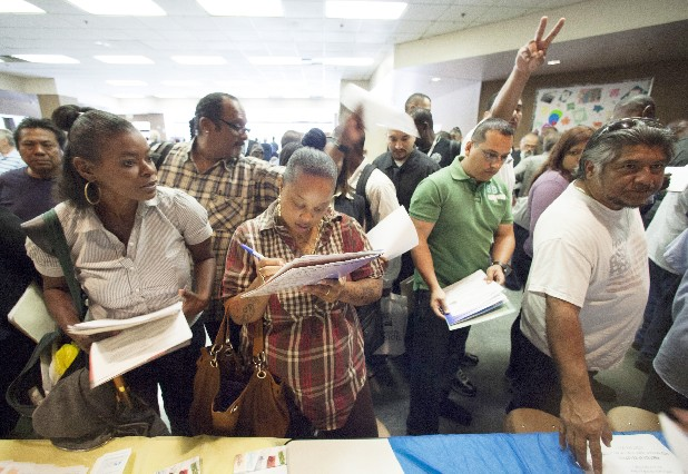 Job seekers gather for employment opportunities at the 11th annual Skid Row Career Fair at the Los Angeles Mission in Los Angeles. U.S. employers created 69,000 jobs in May, the fewest in a year, and the unemployment rate ticked up. The dismal jobs figures could fan fears that the economy is sputtering.