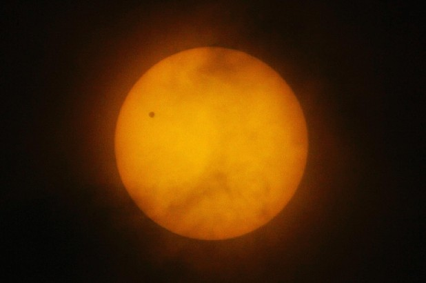 A tiny dot of the planet Venus is seen on the northwest side of the Sun's disc as viewed in Manila, Philippines, on a rare astronomical occasion in this June 8, 2004 file photo. On June 5, 2012, Venus will pass across the face of the sun, producing a silhouette that no one alive today will likely see again. Transits of Venus are very rare, coming in pairs separated by more than a hundred years. This June's transit, the bookend of a 2004-2012 pair, won't be repeated until the year 2117. Fortunately, the event is widely visible. Observers on seven continents, even a sliver of Antarctica, will be in position to see it. (AP Photo/Bullit Marquez)