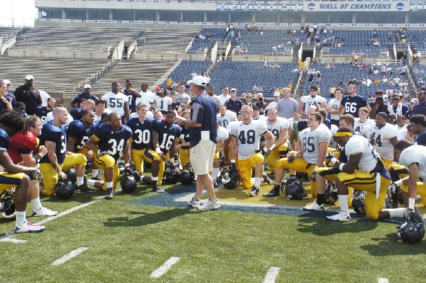 UTC head football coach Russ Huesman talks to his team after the annual Blue/Gold spring game.