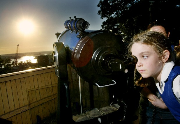 In this June 8, 2004 file photo, amateur astronomer Jody McGowen looks through a telescope to watch the transit of Venus from Sydney's Observatory Hill. Venus will again cross the face of the sun on Tuesday June 5, 2012, a sight that will be visible from parts of Earth. This is the last transit for more than 100 years. (AP Photo/Mark Baker, File)
