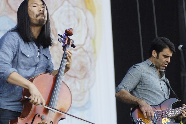Joe Kwon on cello and Bob Crawford on bass of the Avett Brothers perform during the group's set on the main What Stage Friday at Bonnaroo.