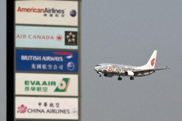 An Air China jet prepares to land at the Capital International Airport in Beijing. Flying this summer doesn't need to be expensive, as search engines, social media, creativity and flexibility can make finding bargain airfares easier.