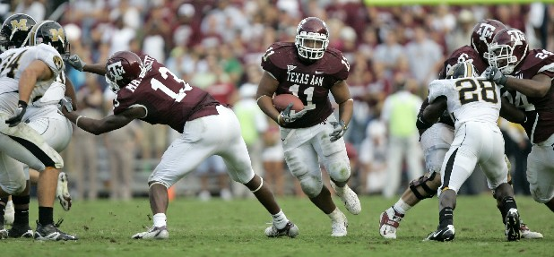 Texas A&M's Jorvorskie Lane (11) rushes up the middle for a gain against Missouri.