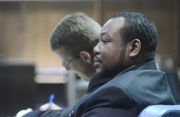 Reginald Tumlin listens during jury selection for his trial Tuesday in Judge Rebecca Stern's courtroom. Tumlin has been charged with felony murder, aggravated child abuse and neglect.