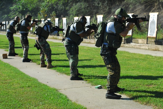 SWAT team members shoot at targets during firing practice at the police firing range off Moccasin Bend Road.