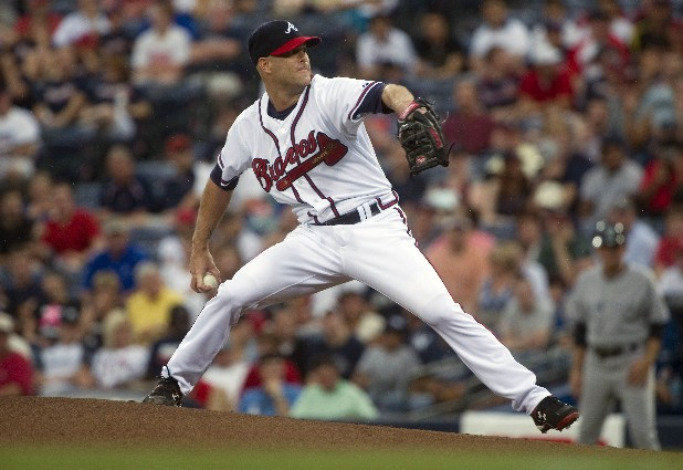 Atlanta Braves pitcher Tim Hudson works the mound against the New York Yankees during the first inning of a baseball game on Wednesday, June 13, 2012, in Atlanta.