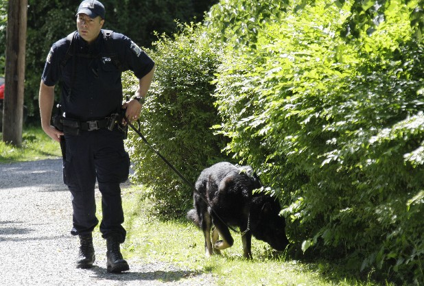 Law enforcement officers search near the home of Dr. Timothy Jorden in Hamburg, N.Y., Thursday, June 14, 2012. Jorden is sought in connection with the hospital shooting death of his ex-girlfriend at Erie County Medical Center in Buffalo, N.Y. on Wednesday.