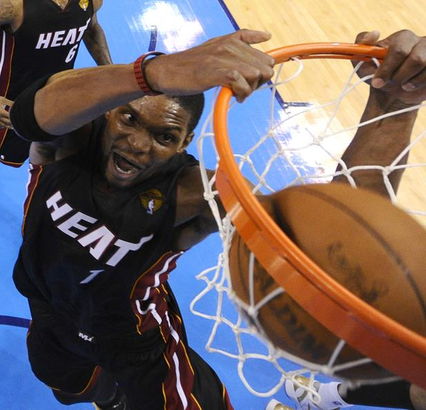 Miami Heat power forward Chris Bosh dunks against the Oklahoma City Thunder during the second half at Game 2 of the NBA finals basketball series, Thursday, June 14, 2012, in Oklahoma City. The Heat won 100-96.