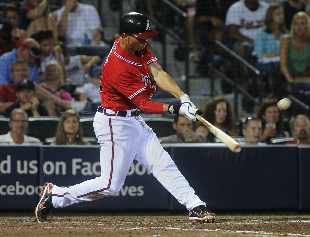 Atlanta Braves shortstop Andrelton Simmons, of Curacao, gets a hit against the Baltimore Orioles during the ninth inning of a baseball game on Friday, June 15, 2012, in Atlanta. Atlanta won 4-2.