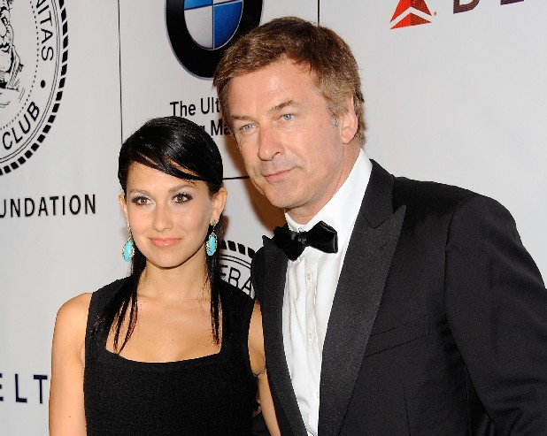 "This June 12, 2012 file photo shows actor Alec Baldwin and his fiancee Hilaria Thomas at The Friars Club and Friars Foundation Honor of Tom Cruise at The Waldorf-Astoria in New York. A New York City news photographer says he was punched by Alec Baldwin outside a marriage license bureau in Manhattan. The Daily News reports that Marcus Santos was snapping images of the ""30 Rock"" star with his fiancée Hilaria Thomas Tuesday, June 19. Santos told the paper that Baldwin grabbed a second news photographer, then started shoving Santos and hit him in the chin. He then walked away. Photos on the newspaper's website appear to show Baldwin shoving the photographer. No police report has been filed. A call to the newspaper's public relations office wasn't returned. (Photo by Evan Agostini/Invision/AP, file)"
