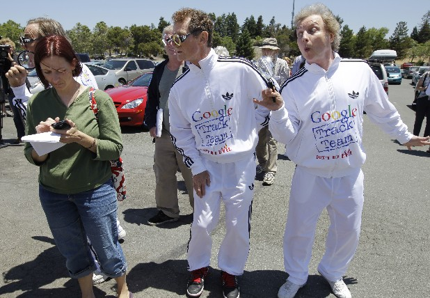 "Consumer Watchdog demonstrator Derek Loughran, center, J. Schwartz, far left, and Don McLeod, right, protests in front of a Google shareholder outside of Google headquarters in Mountain View, Calif., Thursday, June 21, 2012 before the shareholders meeting. Protestors demonstrated to help raise awareness of Google's online tracking policy. They are calling for legislation for ""Do Not Track"" mechanism urged by the FTC. They are protesting information from being gathered by Google without permission. (AP Photo/Paul Sakuma)"