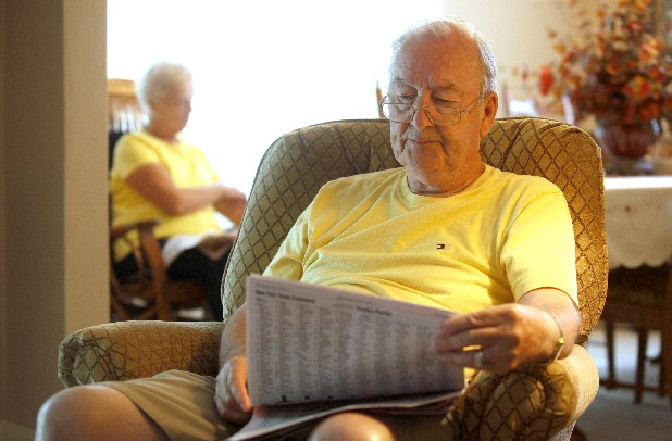 Matt Nevels reads the newspaper with his wife Frances at their Red Bank home Sunday, June 3, 2012. Since leaving Red Bank Baptist Church, many of the Nevels' Sunday mornings have consisted of reading the paper, private devotionals, and watching services on television.