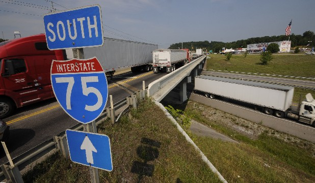At Interstate 75, near Cleveland, large semi trucks cross paths at the bottlenecked area around exit 20. A new Pilot Truck and Auto Plaza has increased traffic to the already crowded two-lane bridge over the interstate, and the state has plans eventually to add lanes so traffic will flow more smoothly.