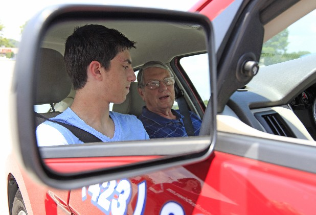 McCallie School student Drew Shikoh, 15, left, listens as Bob Bauer instructs him during his first in-car lesson during a Haman's Driving School class at Northgate Mall on Thursday.