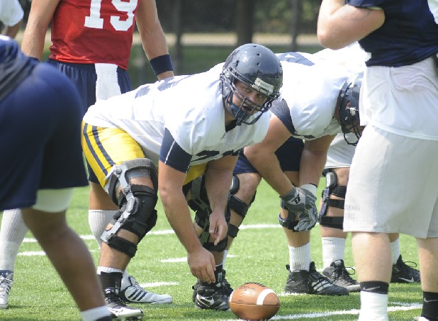 UTC center Patrick Sutton gets into position during practice at Scrappy Moore Field.