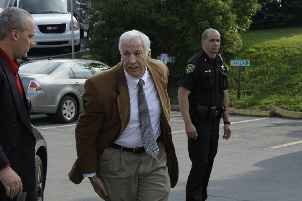 Former Penn State University assistant football coach Jerry Sandusky, center, arrives at the Centre County Courthouse in Bellefonte, Pa., Friday, June 22, 2012.