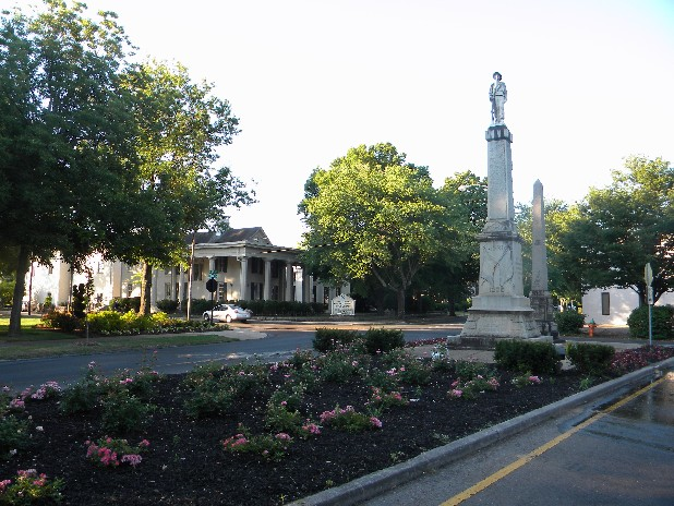 A monument to Confederate soldiers overlooks a flower garden in the middle of North Ocoee Street in Cleveland, Tenn. At the city's request, Lee University's grounds crew will take over the landscaping and maintenance of the spot just across the street from the campus.