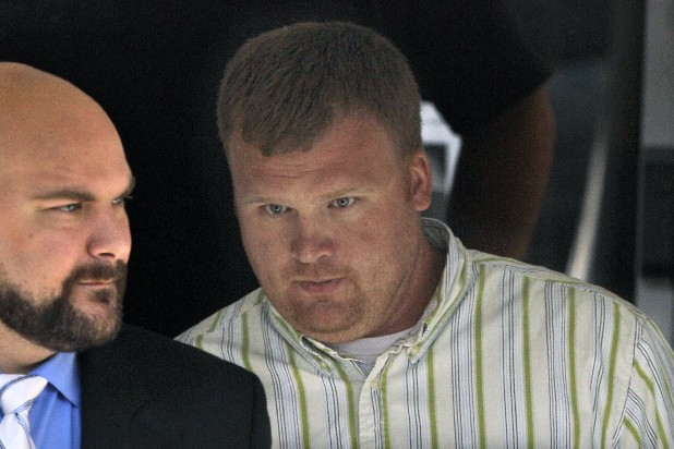 In this June 20, 2012 file photo, Matt Sandusky, right, adopted son of former Penn State assistant coach Jerry Sandusky, leaves the Centre County Courthouse in Bellefonte, Pa., where his father was being tried on charges of child sexual abuse involving 10 boys over a period of 15 years. Matt Sandusky, who released a statement on June 22, 2012 that his father had sexually abused him as well, describes being abused as an 8-year-old boy by his father on a police interview tape obtained by NBC News. (AP Photo/Gene J. Puskar, File)