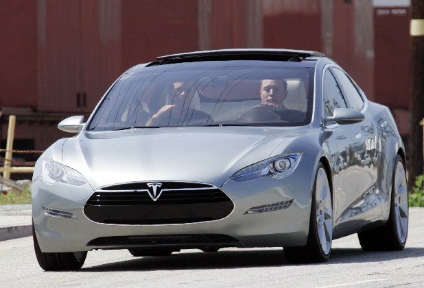 A driver takes Tesla Motors' Model S all-electric car for a spin at Tesla's manufacturing plant in Hawthorne, Calif.