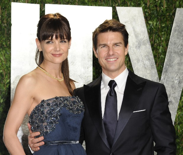 In this Feb. 26, 2012 file photo, actors Tom Cruise and Katie Holmes arrive at the Vanity Fair Oscar party, in West Hollywood, Calif. Cruise and Homes are calling it quits after five years of marriage. Holmes' attorney Jonathan Wolfe said Friday June 29, 2012 that the couple is divorcing, but called it a private matter for the family. (AP Photo/Evan Agostini, File)