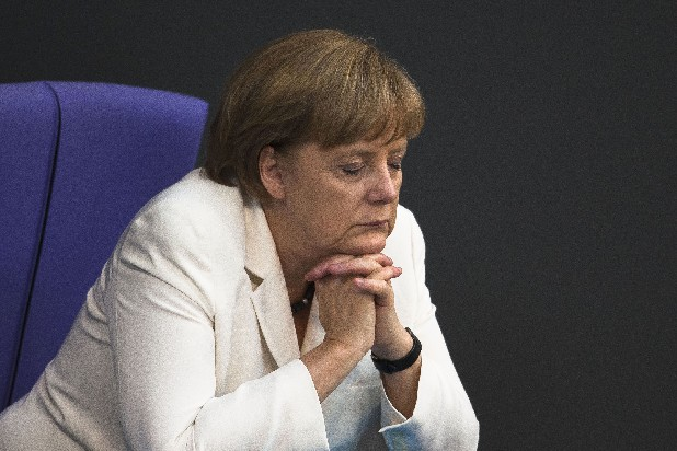 German Chancellor Angela Merkel reacts during the debate after she addresses lawmakers about the decisions of the EU summit at the parliament Bundestag in Berlin on Friday.