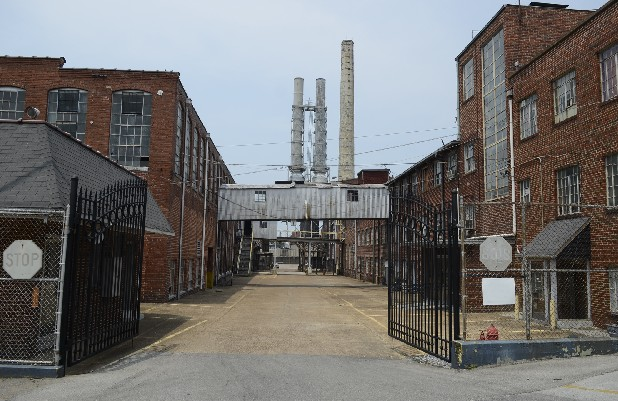 The sprawling former Peerless Woolen Mills complex will go back to the Hutcheson family today