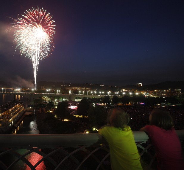 People watch a fireworks display from the Walnut Street Bridge and from Coolidge Park after Pops on the River on Tuesday night.