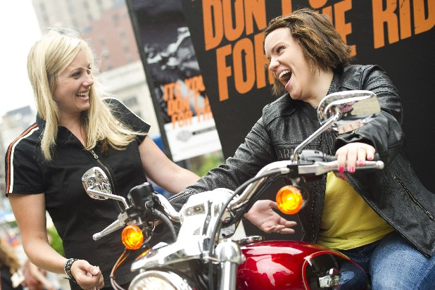 "This June 13, 2012 photo showd Harley-Davidson representative Dana Wilke, left, assisting Lizzy Dabczynsky, 22, of Salt Lake City, Utah, in test riding a motorcycle in New York. The number of women motorcycle riders in the U.S. has increased slowly to about 7.2 million of about 27 million overall in 2009, according to the latest survey by the Motorcycle Industry Council. Dozens of female-only motorcycle clubs have joined more established groups like Women on Wheels. The makers of bikes and gear are reaching out to women like never before through special events and marketing campaigns that include Harley-Davidson's ""No Doubts. No Cages."" program. (AP Photo/Charles Sykes)"