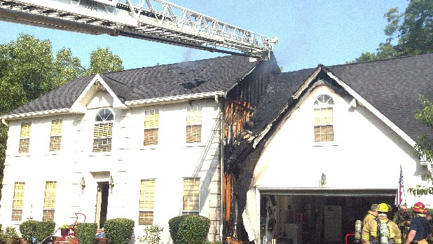 Chattanooga firefighters fight a fire at 705 Creek Drive on Wednesday.