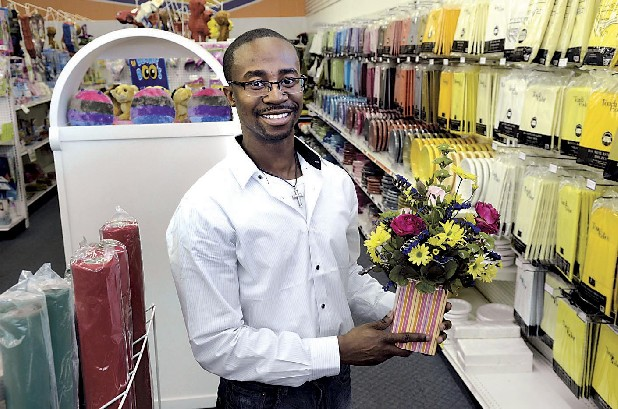 Dr. Trey Rumph, who bought the Balloon Factory on Brainerd Road last year, got startup financing through Rebirth Financial. In addition to balloons, the store sells silk flower arrangements, such as the one he is holding, and matching paper tablecloths, plates and napkins.
