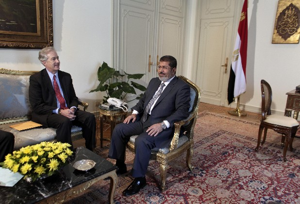 U.S. Undersecretary of State William Burns, left, meets with Egyptian President Mohammed Morsi, right, at the Presidential palace in Cairo, Egypt, Sunday, July 8, 2012. Egypt's official news agency says President Mohammed Morsi has ordered the return of the country's Islamist-dominated parliament that was dissolved by the powerful military.