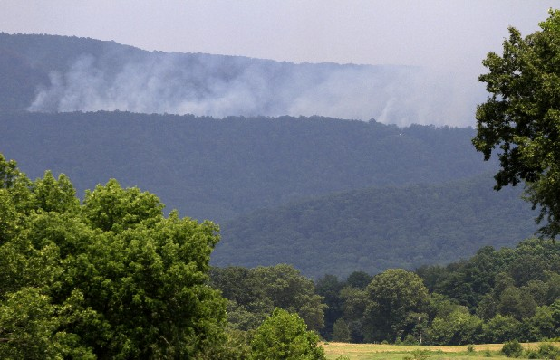 "Smoke from the ""Powerline Fire"" is seen from miles away. The blaze is expected to consume 1,600-acres within the Cherokee National Forest. About 100 personnel, five engines, three helicopters and two dozers are being used to fight the blaze."