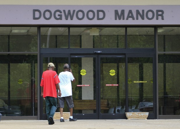 Pedestrians enter Dogwood Manor at 959 Gateway Ave. on Tuesday.