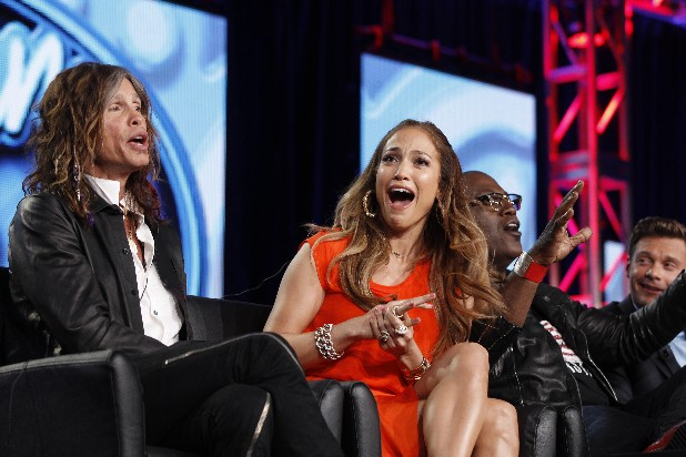 "In this Jan. 8, 2012 photo, ""American Idol"" judge Jennifer Lopez, center, reacts as fellow judge Steven Tyler, left, of Aerosmith makes a joke about wearing Lopez's pants as Randy Jackson and Ryan Seacrest are seen at right during the ""American Idol"" panel at the Fox Broadcasting Company Television Critics Association Winter Press Tour in Pasadena, Calif. ""American Idol"" is on the brink of a crisis, Thursday, July 12, 2012, as judge Steven Tyler is leaving, and fellow judge Jennifer Lopez is dithering about staying put."