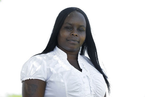 Taneisha Morris, 33, of Detroit, who was scammed on paying a utility and satellite television invoice is shown in Detroit, Thursday, July 12, 2012. A national scam touting a new federal program from President Barack Obama is taking advantage of electric utility customers in several states. The scammers are telling utility customers that President Obama or the federal government will provide credits of up to $1,000 to help offset utility costs. Around the country, the scam has also been spread through text messages, social media and fliers. The scam artists are asking for customers to provide credit card and Social Security numbers.
