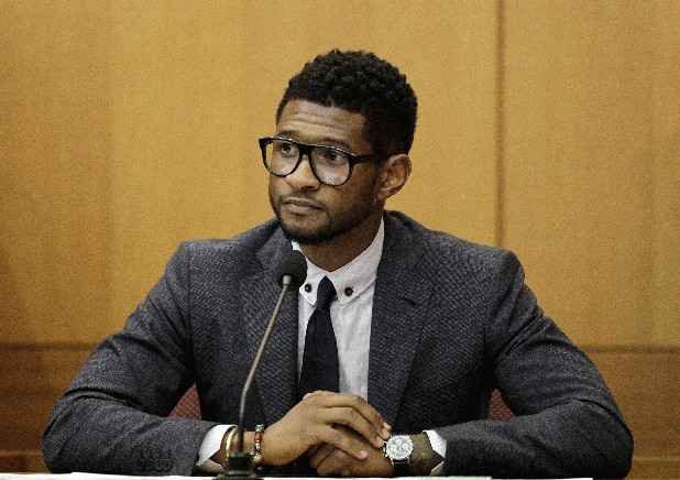 Hip-hop artist Usher Raymond takes the witness stand in court in a legal battle with his ex-wife in a custody fight involving their two sons in this May 22, 2012 file photo taken in Atlanta. Willie A. Watkins funeral home in Atlanta confirmed Saturday July 21, 2012 it is handling funeral arrangements for 11-year-old Kirk Glover. He was the son of Usher's ex-wife Tameka Foster. The boy was run over July 6 by a personal watercraft on Lake Lanier, according to the Georgia Department of Natural Resources