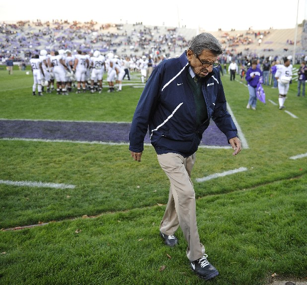 "In this Oct. 22, 2011 file photo, Penn State coach Joe Paterno walks off the field after warmups before an NCAA college football game against Northwestern in Evanston, Ill. NCAA president Mark Emmert says he isn't ruling out the possibility of shutting down the Penn State football program in the wake of the Jerry Sandusky child sex abuse scandal. In a PBS interview Monday night, July 16, 2012, he said he doesn't want to ""take anything off the table"" if the NCAA determines penalties against Penn State are warranted. (AP Photo/Jim Prisching, File)"