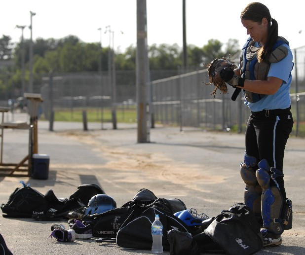Tennessee Fury 95 catcher Cassi Pickett puts on gear during practice at Tyner Recreation Complex. The Fury will be playing in an upcoming Amateur Softball Association national tournament.