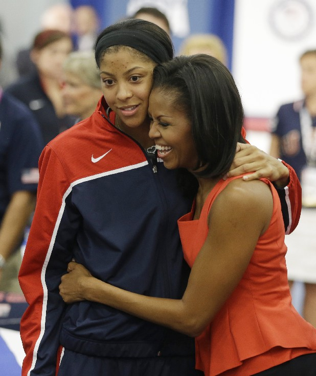 First lady Michelle Obama hugs women's basketball player Candace Parker after speaking at a breakfast with Team USA at the 2012 Summer Olympics, Friday, July 27, 2012, in London.