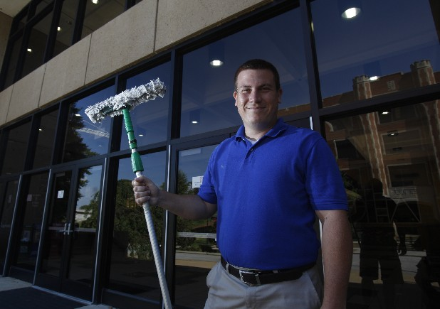 Donnie Mars, owner of New View Window Cleaning, poses for a portrait on the University of Tennessee at Chattanooga campus Monday morning. Marsh is currently a business student at the university.