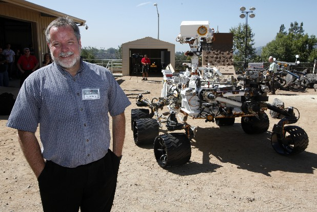 Rob Manning, chief engineer, speaks to media at NASA Mars Yard at NASA's Jet Propulsion Laboratory in Pasadena. Beside Manning is a model of the Mars rover Curiosity. After traveling 8 1/2 months and 352 million miles, Curiosity will attempt a landing on Mars the night on Aug. 5.
