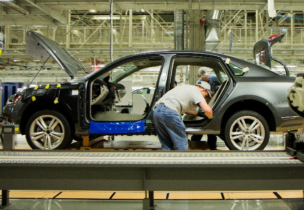 In this March 22, 2012, file photo, workers assemble a Passat sedan at Volkswagen AG's plant in Chattanooga, Tenn.